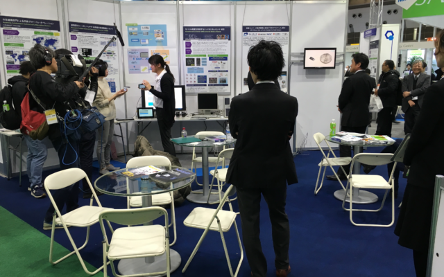 International Nanotechnology Exhibition and Conference interviewing Dr. Yoshikawa at the NIMS booth